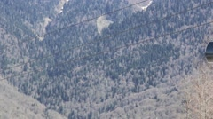 Two Ski Lifts is Moving in Mountains Stock Footage