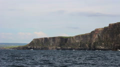 Riding in Boat on Ocean Next to the Cliffs of Moher in Ireland Stock Footage