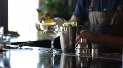 Hands of the barman add alcohol cocktail Stock Footage