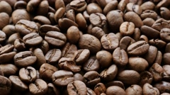 Arabica coffee high quality roasted beans close-up slow tilt 4K 2160p 30fps U Stock Footage