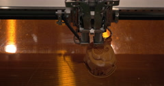 Close-up of mechanism of 3D printer working on printing plastic toys Stock Footage