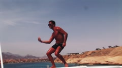 Mulatto topless man dance on roof of yacht at ocean. Recreation. Vacation. Party Stock Footage