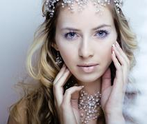 Beauty young snow queen with hair crown on her head, complicate hairstyle Stock Photos