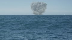 Animated nuclear explosion in sea on a sunny day Stock Footage