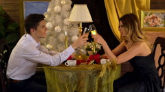 Couple celebrate Xmas New Year in restaurant. Stock Footage