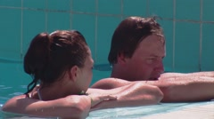Man and woman relax in open swimming pool. Recreation. Entertainment. Vacation Stock Footage