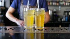 Bartender makes homemade lemonade at a restaurant Stock Footage