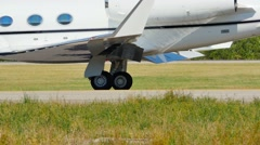 Close up on plane wheel moving on runaway Stock Footage