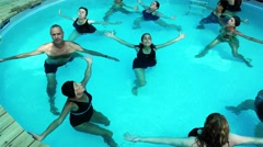 Yogists practice water aqua yoga during Yoga Arava press trip Stock Footage