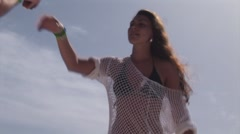 Girl in white tunic sexy dance at open air party on yacht. Drink. Sea. Vacation Stock Footage
