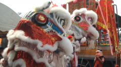 Chinese lion performing in city Stock Footage