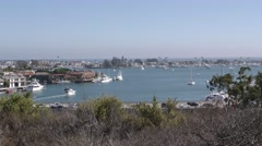 Zoom in of motor boat in bay with busy PCH in foreground. Stock Footage