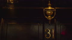 The 31st door on the house apartments Stock Footage