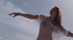 Girl in white tunic energy dance at open air party on yacht. Sea. Vacation. Sun Stock Footage