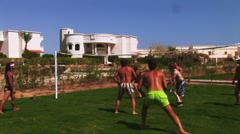 People play volleyball on playground with lawn. Vacation. Entertainment. Fun Stock Footage