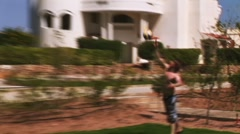 People play volleyball on playground with lawn. Vacation. Ball fly away. Resort Stock Footage