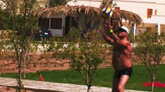 People play volleyball on playground with green lawn. Vacation. Ball fly away Stock Footage