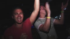 Young men dance on party in nightclub. Raise hands, look in camera. Holidays Stock Footage