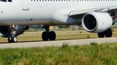 Plane on runaway close up on wheels engine Stock Footage