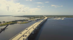 Aerial View of Bridge with Highway Traffic in Coastal Town Stock Footage