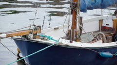 The blue sailboat floating on the river Stock Footage