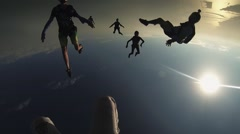 Group of skydivers fly in blue sky. Sunny day. Extreme sport. Professionals Stock Footage