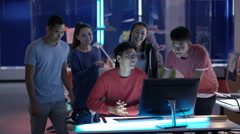 4K Portrait smiling Asian game developers in creative office Stock Footage