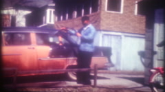 Dad washes the car in the driveway a 1955 Chevrolet-3603 vintage film home movie Stock Footage