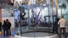 People dance together inside fly station. Simulator of skydiving. Contest Stock Footage