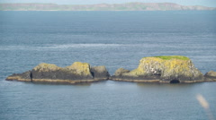 Rocks on the middle of the sea in National Trust Stock Footage