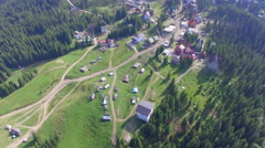 The village in a beautiful forest. Aerial video Stock Footage