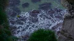 Small waves splashing on the rocks Stock Footage