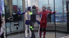Group of people dance inside fly station. Simulator skydiving. Challenge Stock Footage