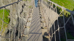 The footbridge in the Carrick-a-Rede Stock Footage