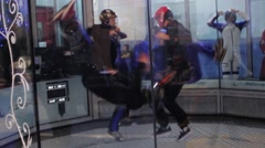 Group of people dance inside fly station. Simulator skydiving. Contest. Flip Stock Footage