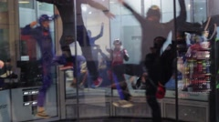 Group of people dance in fly station. Simulator skydiving. Contest. Competition Stock Footage