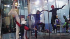 Group of people balance inside fly station. Simulator skydiving. Contest. Team Stock Footage