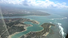 Aerial view of nusa dua, benoa and sanur from plane, slow motion Stock Footage