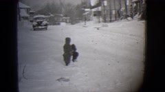 1944: a snowy area is seen with kids MICHIGAN Stock Footage