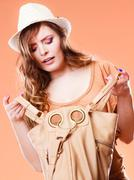 Young woman in summer hat with handbag Stock Photos