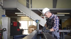 Metalworker with security helmet in workshop Stock Footage