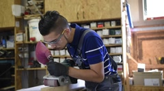 Young man in woodwork training course Stock Footage