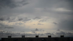 Dark clouds floating over scary city building Stock Footage