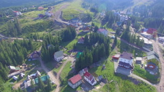 Drone landing above the village. aerial view Stock Footage