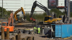 Heavy Equipment used in excavation work at a construction site Stock Footage
