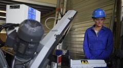 Metalwork student girl training in workshop Stock Footage