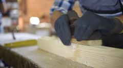 Closeup of carpenter's hands working wood Stock Footage