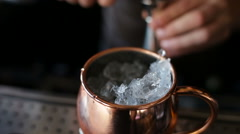 The bartender makes a cocktail in a copper bowl Stock Footage