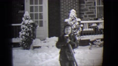 1944: clearing the pathway daddy and the kids before mummy comes back home  Stock Footage