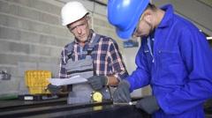 Metalwork student training in workshop Stock Footage